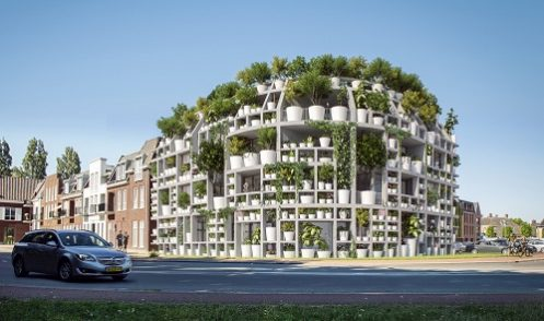 Zielony budynek mieszkalno-biurowy,  na którym rosną drzewa!